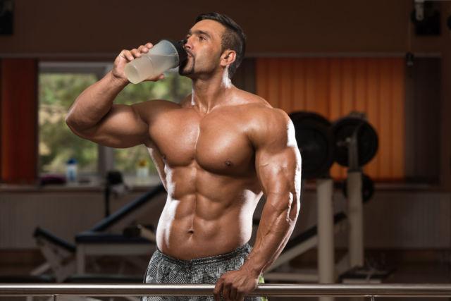 35999816 - muscular man drinking a water bottle